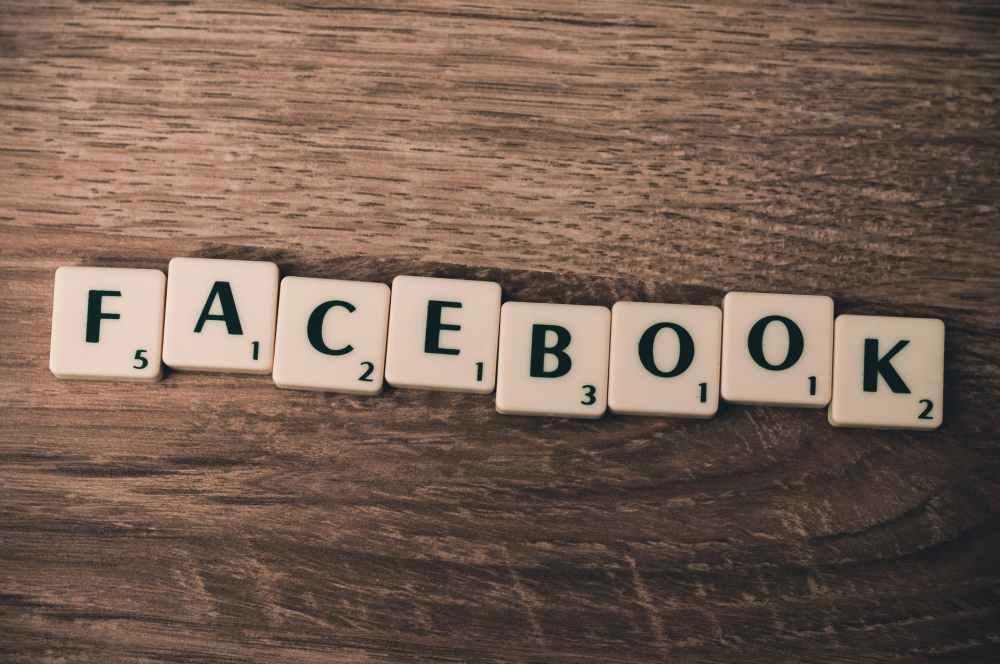Facebook spelled out in Scrabble letter tiles